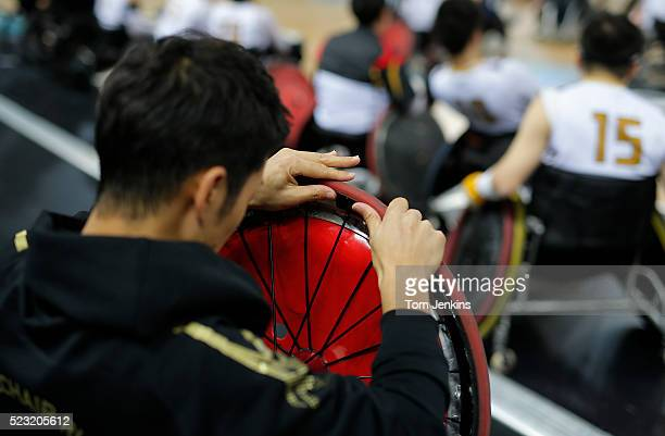 Quick tyre repairs for Japan during a match in the World Wheelchair rugby challenge at the Copper Box Arena Queen Elizabeth Olympic Park on October...