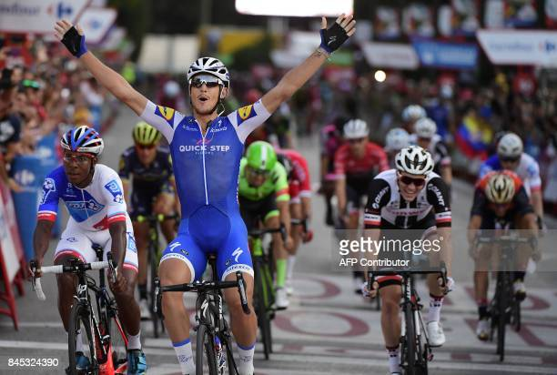 QuickStep Floors' Italian cyclist Matteo Trentin celebrates as he crosses the finish line winning the 21th and last stage of the 72nd edition of 'La...