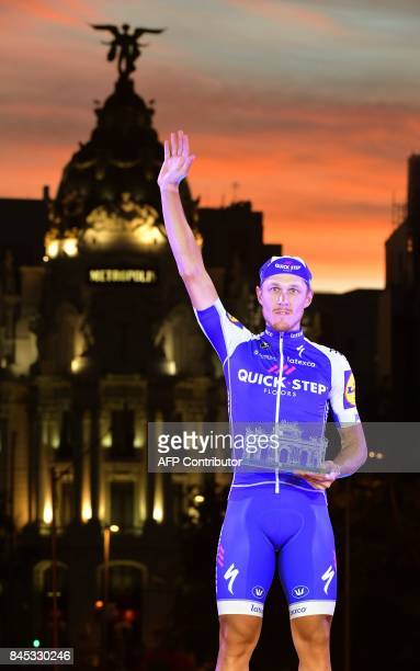 QuickStep Floors' Italian cyclist Matteo Trentin celebrates on the podium winning the 21th and last stage of the 72nd edition of 'La Vuelta' Tour of...