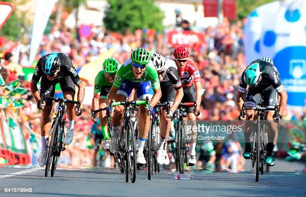 TOPSHOT QuickStep Floors' Italian cyclist Matteo Trentin celebrates while crossing the finish line of the 13th stage of the 72nd edition of La Vuelta...