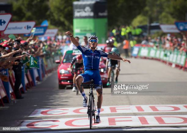 QuickStep Floors Team's French cyclist Julian Alaphilippe celebrates as he crosses the finish line to win the 8th stage of the 72nd edition of La...