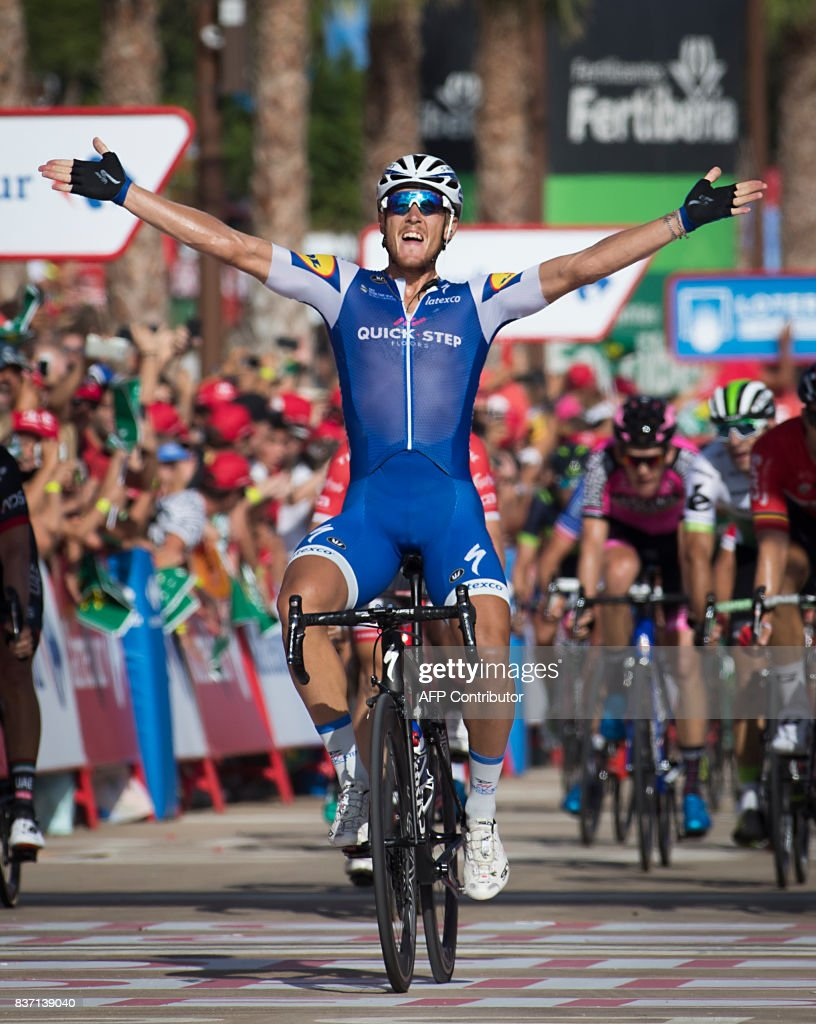 Quick-Step Floors Team's Italian cyclist Matteo Trentin celebrates as he crosses the finish line to win the 4th stage of the 72nd edition of 'La Vuelta' Tour of Spain cycling race, a 198,2km route between Escaldes-Engordany to Tarragona on August 22, 2017. /