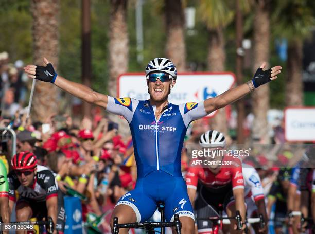 """Quick-Step Floors Team's Italian cyclist Matteo Trentin celebrates as he crosses the finish line to win the 4th stage of the 72nd edition of """"La..."""