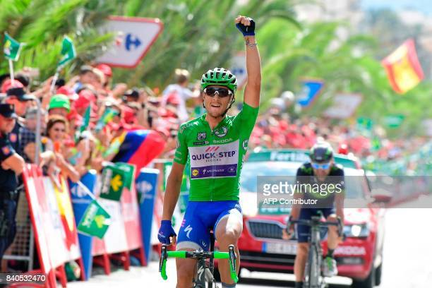 QuickStep Floors Team's Italian cyclist Matteo Trentin celebrates as he crosses the finish line of the 10th stage of the 72nd edition of La Vuelta...
