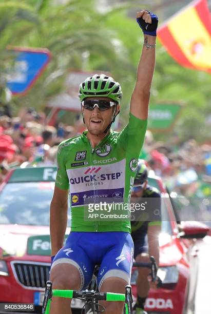 QuickStep Floors Team's Italian cyclist Matteo Trentin celebrates as he crosses the finish line to win the 10th stage of the 72nd edition of 'La...