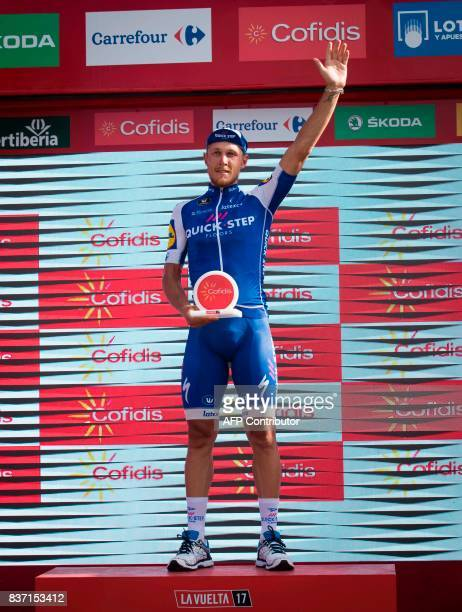 """Quick-Step Floors Team's Italian cyclist Matteo Trentin celebrates on the podium after winning the 4th stage of the 72nd edition of """"La Vuelta"""" Tour..."""
