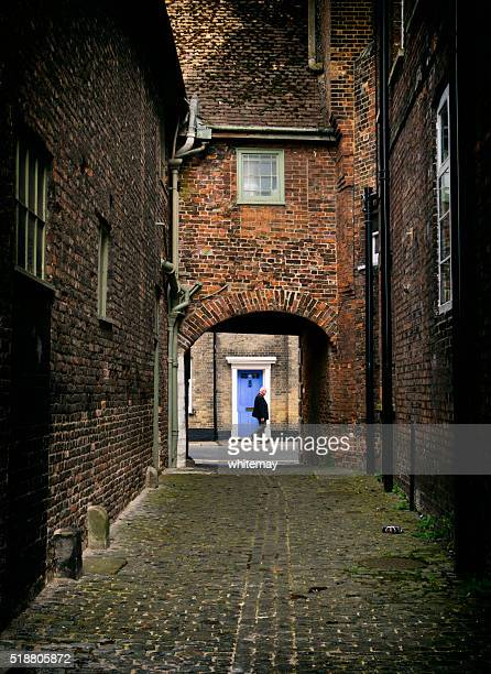 quiet alleyway in king's lynn - king's lynn stock photos and pictures