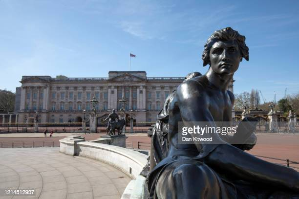Quiet Buckingham Palace and Queen Victoria Monument on March 24, 2020 in London, England. British Prime Minister, Boris Johnson, announced strict...
