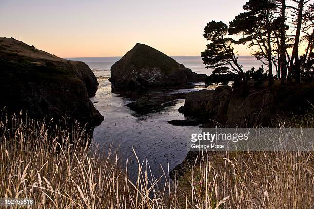 A quiet inlet cove and cliffs overlook the Pacific Ocean at sunset on September 8 near Mendocino California Located a few hours north of San...