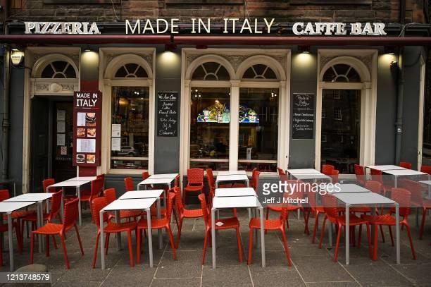 A quiet Italian restaurant in the Grassmarket on March 20 2020 in Edinburgh United Kingdom British Prime Minister Boris Johnson announced that the...