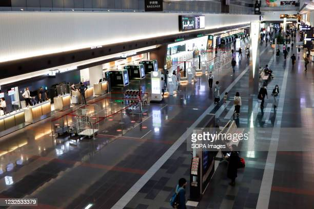 Quiet lobby with a few travellers at Tokyo Haneda International Airport following the declaration of a state of emergency.