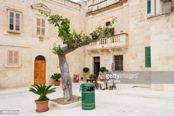 quiet maltese little square - dafos stock photos and pictures