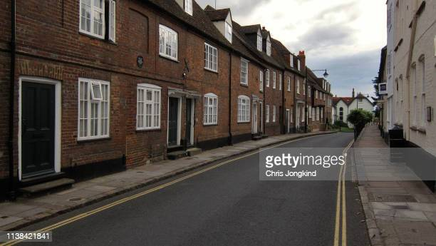 quiet residential street with townhouses - street stock pictures, royalty-free photos & images