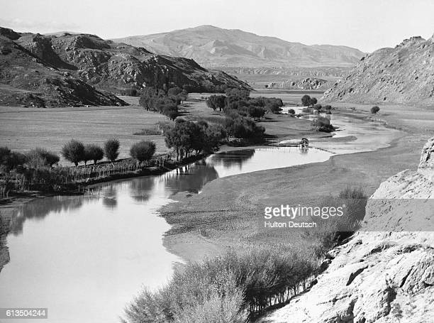 A quiet river winds through the foothills of Mount Ararat in Kurdistan along the TurkishIranian border