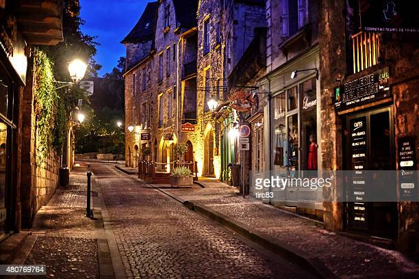 quiet street scene in sarlat france at dusk - sarlat stock photos and pictures
