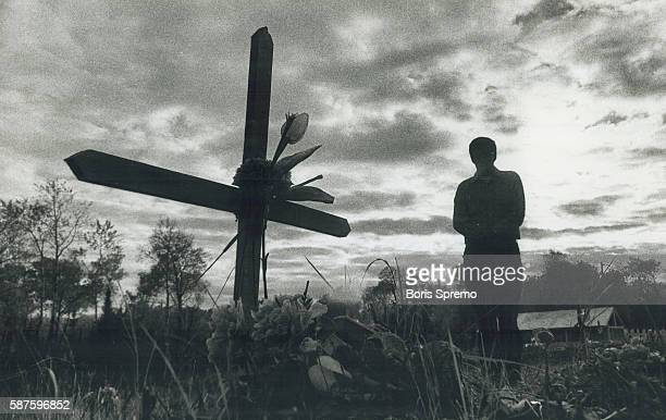 Quiet time Ojibwa Indian contemplates a family member's death at a cemetery at Grassy Narrows reservation near Kenora For 15 years the northwest...