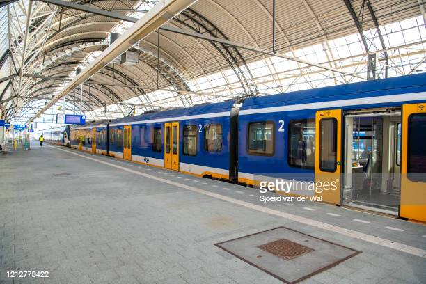 Quiet train station during rush hour after the Dutch government announced new measures for prevention of spreading of the Corona Covid-19 virus on...