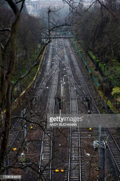 Quiet train tracks are pictured outside Waverly Station in Edinburgh Scotland on March 26 2020 after the government ordered a lockdown to help stop...