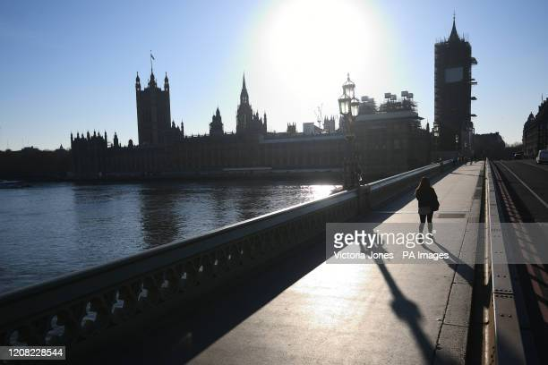 A quiet Westminster Bridge London in the normally busy evening rush hour after Prime Minister Boris Johnson made the decision to put the UK in...