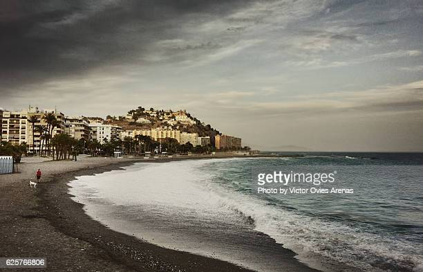 Quietness on San Cristobal beach after sunset in Almuñecar, most important beach resort in Granada, Spain