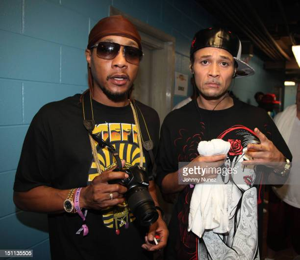 DJ Quik and Bizzy Bone attend the 2012 Rock The Bells music festival at the PNC Bank Arts Center on September 1 2012 in Holmdel New Jersey