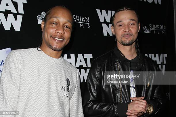 Quik and Rapper Bizzy Bone arrive at the What Now premiere at Laemmle Music Hall on March 10 2015 in Beverly Hills California
