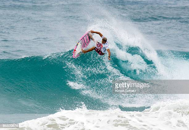 Quiksilver wildcard and giant-slayer Julian Wilson of Australia surfs on a stormy two- meter wave during his Round 4 heat at the Quiksilver Pro Gold...