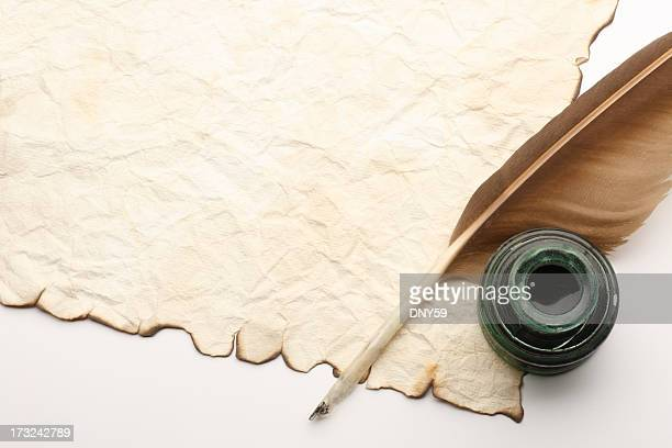 quill and inkwell on top of old blank document - quill pen stock photos and pictures