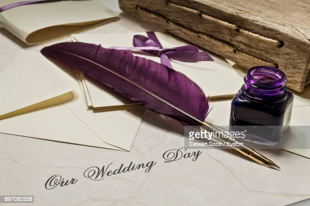 quill pen with ink on envelope - quill pen stock photos and pictures