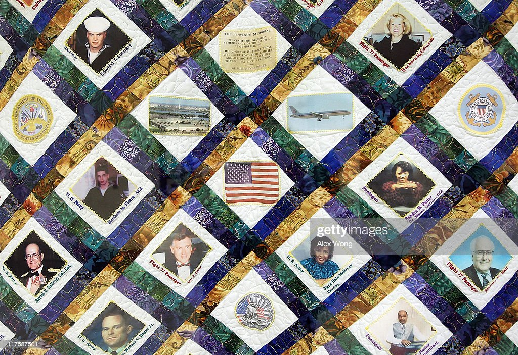 A quilt that features the victims of the Pentagon attack hangs on a wall of the Pentagon Memorial Quilts Corridor where 21 quilts, of more than 100 in the collection that serve as a historical record of the tragic events of 9/11, are on display June 28, 2011 in Arlington, Virginia. This year is the 10th anniversary of the September 11 terrorist attacks, in which 184 people were killed at the Pentagon.