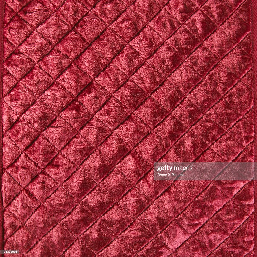 Quilted red velvet : Stock Photo