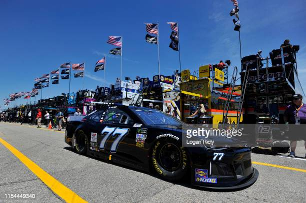 Quin Houff driver of the Spire Motorsports Chevrolet drives through the garage during practice for the Monster Energy NASCAR Cup Series FireKeepers...