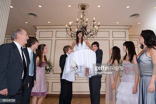 Quinceanera girl being lifted