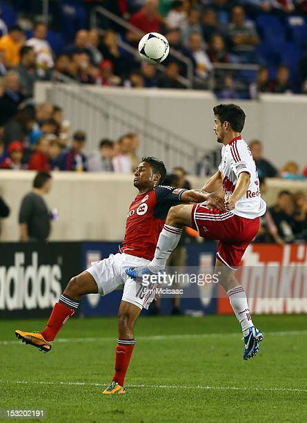 Quincey Amarikwa of the Toronto FC in action against Heath Pearce of the New York Red Bulls at Red Bull Arena on September 29, 2012 in Harrison, New...