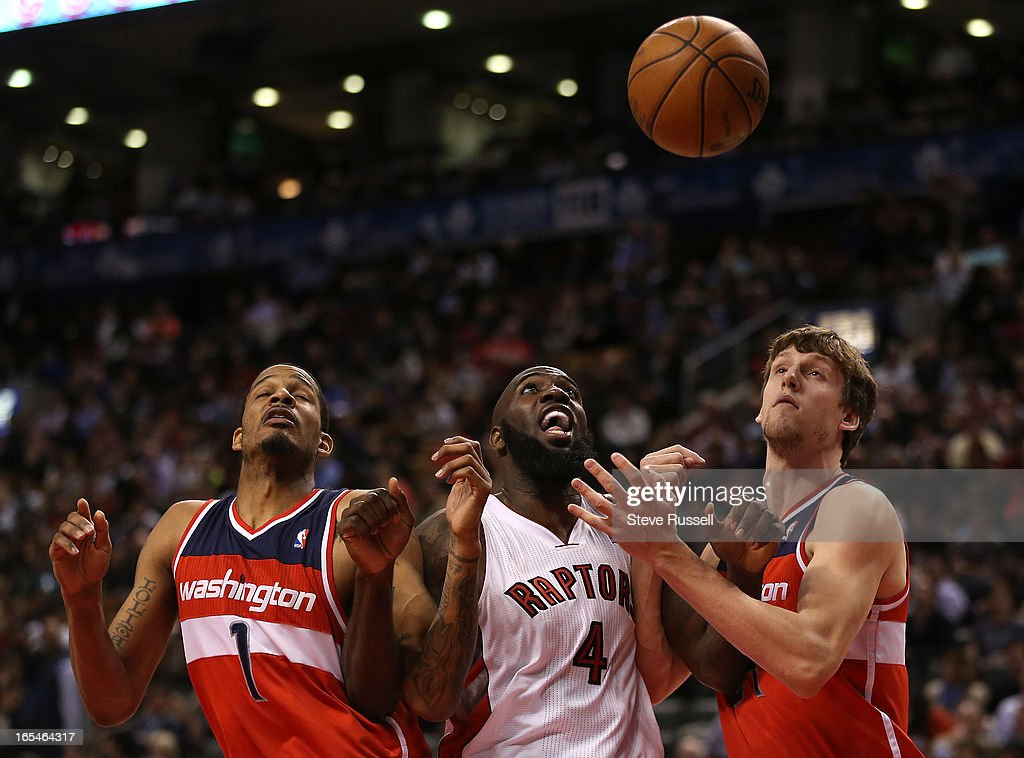 Quincy Acy battles with Trevor Ariza and Jan Vesely in second half action as the Toronto Raptors beat the Washington Wizards 88-78 at the Air Canada Centre in Toronto.