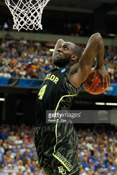 Quincy Acy of the Baylor Bears dunks against the Kentucky Wildcats in the first half during the 2012 NCAA Men's Basketball South Regional Final at...