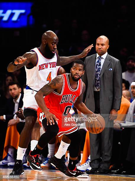 Quincy Acy of the New York Knicks guards Aaron Brooks of the Chicago Bulls in the fourth quarter during a game at Madison Square Garden on October 29...