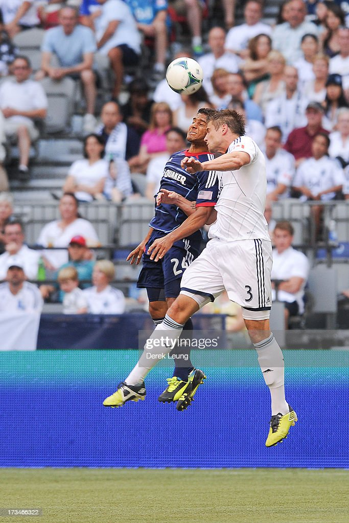 Quincy Amarikwa #24 of Chicago Fire jumps for a header against Brad Rusin #3 of the Vancouver Whitecaps during an MLS Match at B.C. Place on July 14, 2013 in Vancouver, British Columbia, Canada. The Vancouver Whitecaps won 3-1.