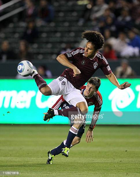 Quincy Amarikwa of the Colorado Rapids jumps to control the ball against Ben Zemanski of Chivas USA at The Home Depot Center on March 26 2011 in...