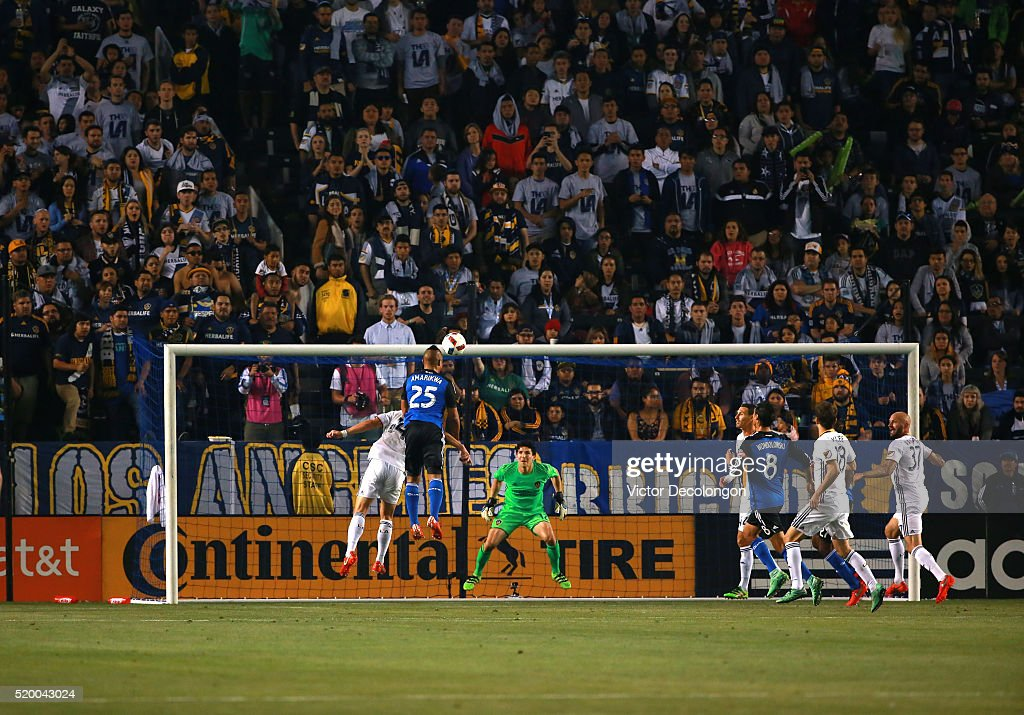 Quincy Amarikwa #25 of the San Jose Earthquakes goes up to head the ball as goalkeeper Brian Rowe #12 of the Los Angeles Galaxy looks to make the save during the MLS match at StubHub Center on March 19, 2016 in Carson, California. The Galaxy defeated the Earthquakes 3-1.
