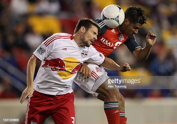 Quincy Amarikwa of Toronto FC and Heath Pearce of the New York Red Bulls battle for the ball at Red Bull Arena on September 29, 2012 in Harrison, New...