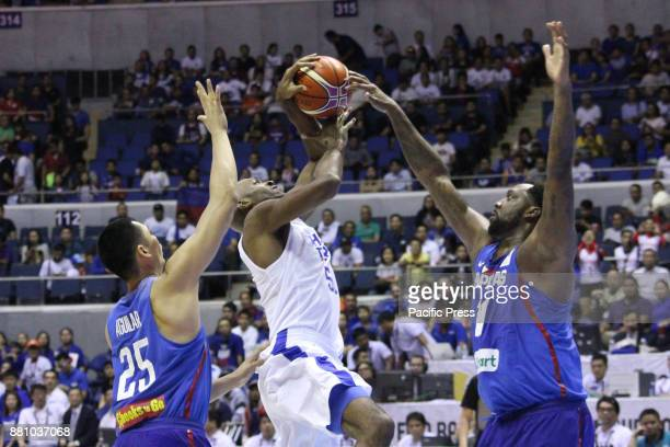 Quincy Davis of Chinese Taipei tries to shoot the ball over Andray Blatche and Japeth Aguilar of the Philippines during their FIBA World Cup...