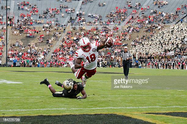 Quincy Enunwa of the Nebraska Cornhuskers dives into the end zone for an eightyard touchdown ahead of Leroy Clark of the Purdue Boilermakers in the...