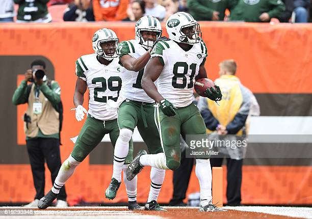 Quincy Enunwa of the New York Jets celebrates his touchdown with Bilal Powell and Charone Peake during the third quarter against the Cleveland Browns...