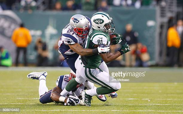 Quincy Enunwa of the New York Jets in action against Tavon Wilson and Duron Harmon of the New England Patriots on December 27 2015 at MetLife Stadium...
