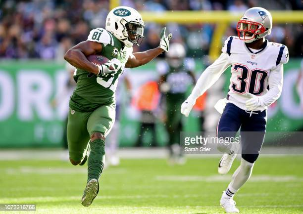Quincy Enunwa of the New York Jets is pursued by Jason McCourty of the New England Patriots during the first half at MetLife Stadium on November 25...
