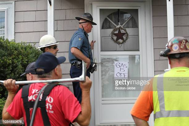 Quincy firefighters and police officers and Columbia Gas Company workers go house by house on Pleasant Street in North Andover MA using locksmiths...