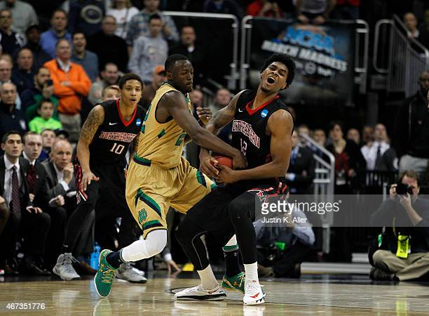 Quincy Ford of the Northeastern Huskies plays against Jerian Grant of the Notre Dame Fighting Irish during the second round of the 2015 NCAA Men's...