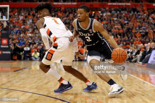 Quincy Guerrier of the Syracuse Orange guards Cassius Stanley of the Duke Blue Devils during the first half of an NCAA basketball game at the Carrier...