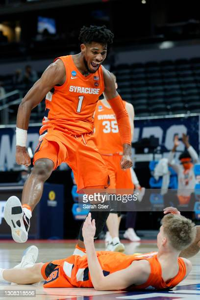 Quincy Guerrier of the Syracuse Orange reacts after Marek Dolezaj drew a foul against the West Virginia Mountaineers in the first half of their...